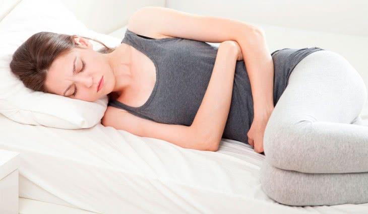 Болит низ живота при молочнице